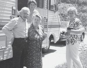 """Pictured are the late Bill and Cindy Howard, their daughter Oma Hatton and Anna L. Watkins of Florida, who came for a vacation with her son Ben and wife at Carr Creek Lake. Whitesburg correspondent Mrs. Hatton says, """"We sure enjoyed it."""""""