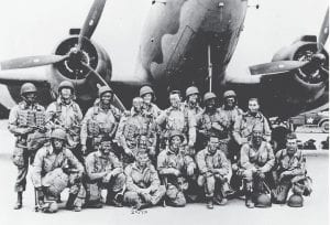 FROM 1944 — This photo shows Pvt. Raymond Smith, seated third from left, with the other members of his paratrooper jump crew after the D-Day invasion of France in WWII. The July 6, 1944 edition of The Mountain Eagle carried the news that Smith, of Thornton, was the first Kentuckian to touch French soil during the June 6, 1944 event. Smith's widow, Irene Smith, and daughter, Liz Simon, now live at Mayking.