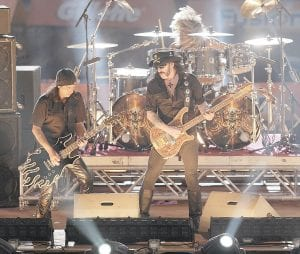 German doctors say they treated a man whose headbanging habit ultimately led to a brain injury at a concert by Motorhead (above), but they say the risk to fans is so small they shouldn't give up their rhythmic ways. (AP Photo)