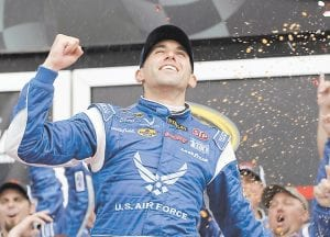 Aric Almirola celebrated in Victory Lane after winning the NASCAR Sprint Cup Series auto race at Daytona International Speedway. (AP Photo)