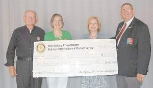 Pictured are (left to right) Whitesburg Rotary Club President Larry Whitaker, Rotary members Barbara Ison and Margaret Hammonds, and Rotary District Governor Jack McAllister.