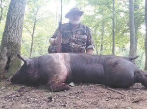 Columnist Steve Brewer wants all Kentucky hunters to be able to experience the thrill of hunting a wild boar, like this Brewer killed last week.