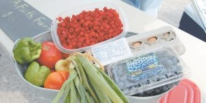 Peppers, tomatoes, onions and eggs bought at the Letcher County Farmers Market are used to make breakfast burritos through the Summer Food Service Program.