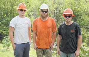 Trevor Noble of Jenkins, Bryan Adams of Blackey, and Andrew Isom of Little Colly were photographed after last week's rescue operation.