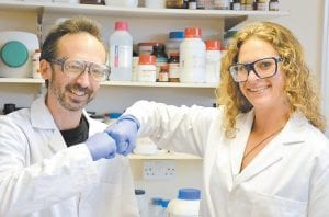 Researchers David Whitworth, left, and Sara Mela, posed for a photo in a lab in Aberystwyth, Wales. (AP Photo)