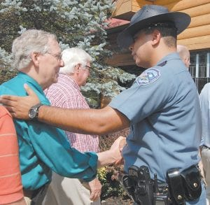 Senate Majority Leader Mitch McConnell was greeted by Whitesburg Police Chief Tyrone Fields before McConnell spoke to an enthusiastic crowd at Pine Mountain Grill in Whitesburg. (Photo by Sally Barto)