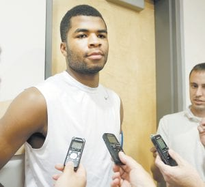 """KEY PART OF TALENTED TEAM — Kentucky's Andrew Harrison spoke to the media before practice last week in Lexington. Guards Andrew and his twin brother Aaron Harrison feel they have unfinished business and want to become better college players. """"Me, as a leader, I'm going to go down there and try to win every game every time I step on the court,"""" Andrew Harrison said. """"I'm going to make sure my teammates are focused and ready to play."""" (AP Photo/James Crisp)"""