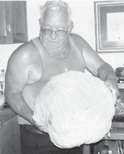 """Elzie Ray Hatton is pictured with an 11½ pound head of cabbage which was given to him by his neighbors. Whitesburg correspondent Oma Hatton says, """"I've never seen one that big."""""""