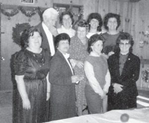 The late Bill and Cinda Howard are pictured with their seven daughters, Oma, Louise, Kathleen, Della, Betty, Joanne and Judy at a Christmas gathering in 1984. Their daughter Della died in 1985.