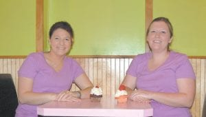 Icing on the Cake owners Becky Pigman and Kendra McIntosh posed for a photo in downtown Whitesburg.