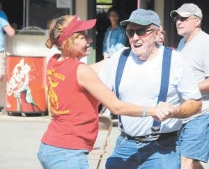Hiram Collins was all smiles while dancing with Sandy Blair to the live music at the Jenkins Homecoming Days festival.