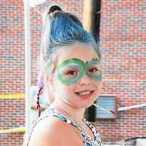Kayleigh Mullins proudly sported wild hair and face paint.