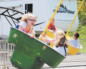 Sheridan Wolford, left, and Autumn Isaac take a spin on one of the carnival rides.