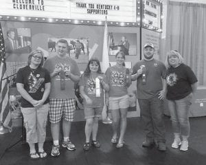 The Letcher County 4-H Horticulture Team/Senior Division won third place in state competition at the Kentucky State Fair. In individual competition, Cody received a blue ribbon, Martha a white ribbon, and Logan and Carla red ribbons. Cody and Martha are home schooled, and Carla and Logan attend Letcher County Central School. Pictured are (left to right) 4-H Agent Crystal Sparks, Cody Adams of Jenkins, Martha West of Premium, Carla Sturgill of Dry Fork, Logan Dollarhide of Cowan, and 4-H Assistant Lee Adams.