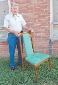 Woodworking expert Willie Spangler poses with the prototype of a chair he made that was shown at the 1964 World's Fair.