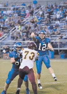 LCC quarterback Zane Blair (12) gets protection as he fires a pass. (Photo by Brandon Meyer/B. Meyer Images)