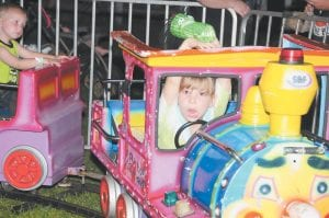 Nevaeh Sturgill looked to be steering with her chin as she filled the role of engineer at the train ride at Isom Days.