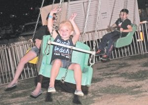 Jaeleigh Breeding was all smiles as she took a spin on the swings at the Isom fairgrounds.