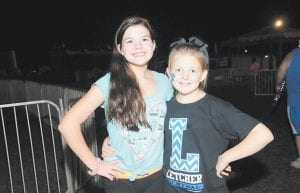 Brooklyn Bentley, left, and Allison Collier posed for a photo between rides at the Isom Days carnival.