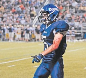 Letcher County Central running back Hunter Hall walked off the field between plays during the first half with blood streaming down his arm. (Photo by Chris Anderson)