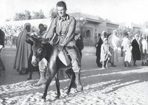 Then-solder Harry M. Caudill of Whitesburg wrote about his experiences with Arabs in North Africa in the September 21, 1944 edition of The Mountain Eagle. Above, native spectators smiled as Corp. Harold D. Ramey, of Los Angeles, Calif., crossed the finish line the winner in an impromptu donkey race held by U.S. soldiers stationed somewhere in Tunisia. (AP Photo)