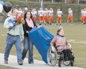 Newly-crowned Letcher County Central High School Homecoming Queen Casey Begley was escorted by her father Therman Begley and LCCHS teacher Ashley Bentley during homecoming activities Friday night. (Photo by Tonya Aslinger)