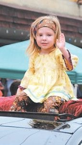 Little Miss Neon winner Chloe Wright gave a wave to the crowd during the Neon Area Days parade on Saturday.