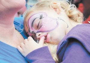 Meredith Burns caught a quick nap while awaiting the start of the Neon Area Days parade.