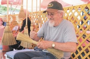 Larry Counts, of Pound, Virginia made a broom during the festival on Saturday.