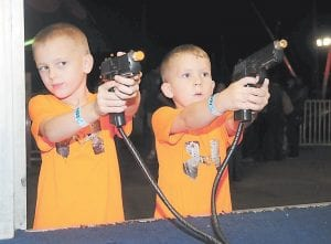 Hank and Mason Stephens had prizes in their sights at the Mountain Heritage carnival.