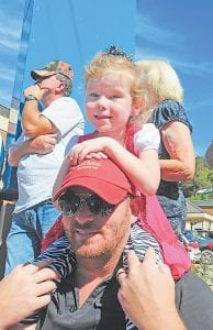 Kiley Hall, of Jenkins, provided the best seat in the house for his daughter, Alli, during Saturday's Mountain Heritage parade.