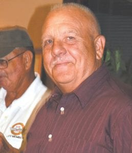 Former Letcher County Jailer Gary Cornett accepted a Mountain Heritage Festival award on behalf of his late father, Vernon Cornett, who had a long career as a barber in Letcher County.