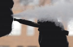 An e-cigarette is demonstrated in this photo. A new government study by the Centers for Disease Control and Prevention suggests the growing trend in U.S. adults who have tried electronic cigarettes may be leveling off. (AP Photo)