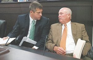PREPARING FOR NEXT SESSION — Senate Democratic Caucus Chair Johnny Ray Turner, D-Prestonsburg (right), discussed legislation with Sen. Ray Jones, D-Pikeville, on Tuesday during the October meeting of the Interim Joint Committee on Transportation in Frankfort. The 2015 session of the full Kentucky General Assembly begins January 6. Turner's senatorial district includes all of Letcher County.