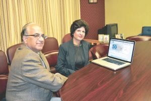 Rakesh Sachdeva M.D., and his wife, Seema Sachdeva M.D., were photographed on Monday after purchasing the first tickets for a new commercial air service in Pikeville.