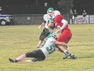 Jenkins's Austin Fields wrapped up the ball-carrier during Friday's win. (Photo by Chris Anderson)