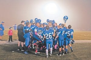FRIDAY NIGHT (FOG) LIGHTS — As fog sets in over the Letcher Central football field, the Cougars celebrated their Friends of Coal Bowl victory over the Harlan County Black Bears. (Photo by Chris Anderson)