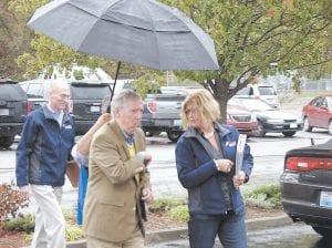 U.S. Senator Mitch McConnell walked under an umbrella held by a campaign assistant as he made his way into the Whitesburg Medical Clinic Monday. (Photo by Ben Gish)