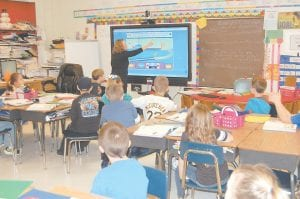 While teaching a lesson on relative position, motion and speed, Sharie Bailey, a third grade teacher at West Whitesburg Elementary School, used an InFocus Mondopad Monday morning to show her students how different types of flooring affect the speed of a car. Each school in the Letcher and Jenkins school districts received a 55-inch touch display and a classroom set of tablets through an Appalachian Renaissance Initiative grant obtained by Kentucky Valley Educational Cooperative (KVEC) and funded by U.S. Department of Education. (Photo by Sally Barto)