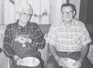 The late Bill Howard and Willard Maggard were photographed at a long ago church dinner at Cowan Church.