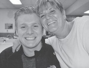 Beau Hatton, a senior at Letcher County Central High School and son of Chris and Sara Hatton, is pictured with his aunt, Judy Greene, at the Howard family reunion. He is the great-grandson of Whitesburg correspondent Oma Hatton.