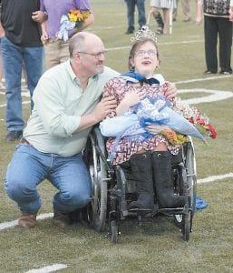 Therman Begley shared in the joy his daughter Casey was experiencing last month when she was crowned homecoming queen at Letcher County Central High School. He said it was the greatest day of her life. Casey died last week of complications of the birth defect spina bifida. (Photo courtesy Tonya Aslinger)