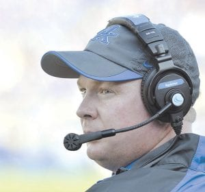 Coach Mark Stoops continues to draw praise for the work he is doing to build a winning football program at the University of Kentucky, writes columnist Bob Watkins. (AP photo)