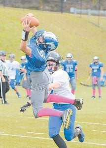 Gregory Kincer stretched to haul in a pass during the Letcher County Central Middle School Football Team's 38-12 win over Paintsville in the quarterfi- nals of the 8th Grade Division 3 Playoffs. The Cougars will face Caldwell County in the semifinals in Lexington on Sunday.