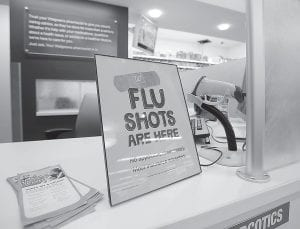 Forget about Ebola, chances are astronomically higher that you have the flu or some other common bug. Doctors say if you're really worried about your health you will get a flu shot. (AP Photo)