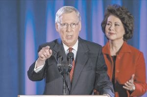 Senate Minority Leader Mitch McConnell joined by his wife, former Labor Secretary Elaine Chao, celebrated with his supporters at an election night party in Louisville. McConnell won a sixth term in Washington, with his eyes on the larger prize of GOP control of the Senate. (AP Photo/J. Scott Applewhite)