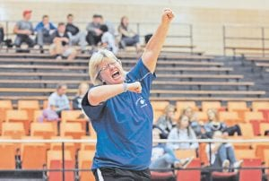 Letcher County Central High School volleyball coach Betty V. Caudill reacted after her squad defeated Hazard to claim the 14th Regional Championship and a trip to the KHSAA Girls' State Volleyball Tournament in Louisville later this week. The Cougars will face McCracken County on Friday morning. (Photo by Chris Anderson)