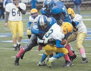 Letcher Middle School's Matthew Baker makes a solo tackle during the playoffs.
