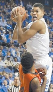 BIG MAN ON CAMPUS — Kentucky's Karl-Anthony Towns, top, pulled down a rebound over Pikeville's KK Simmons during the second half of an exhibition Sunday in Lexington. Kentucky won 116-68. (AP Photo/James Crisp)