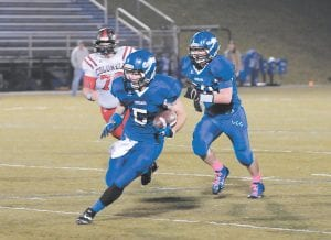 Running back Hunter Hall (5) was among the stars for LCC. (Photo by Chris Anderson)